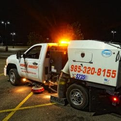 Power Sweeping in Retail Parking Lot with Truck