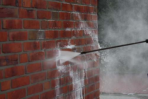 Power Washing Brick Wall